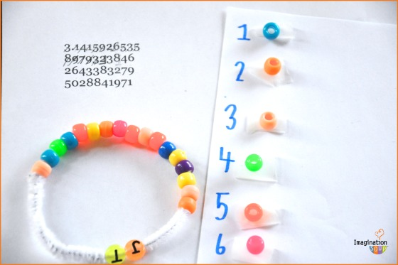 Beads and a pipe cleaner being used to make a bracelet