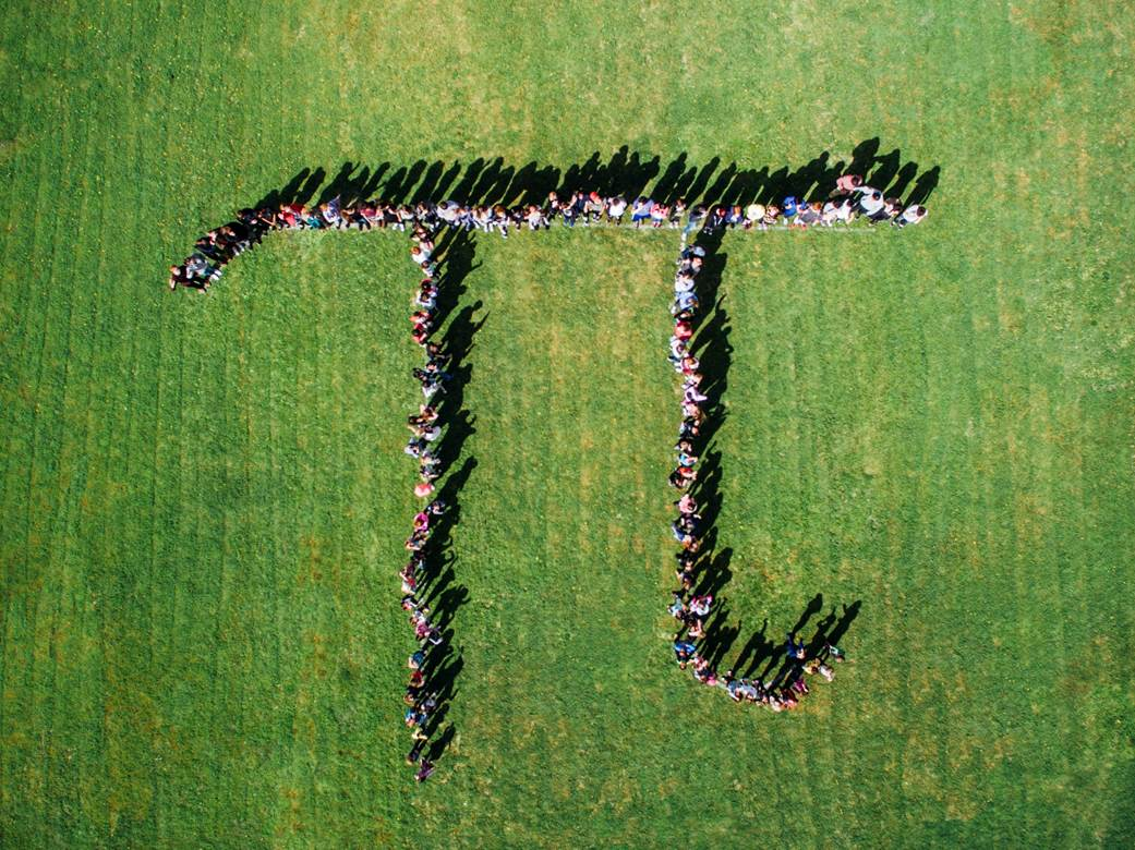 People forming a pi symbol in a field